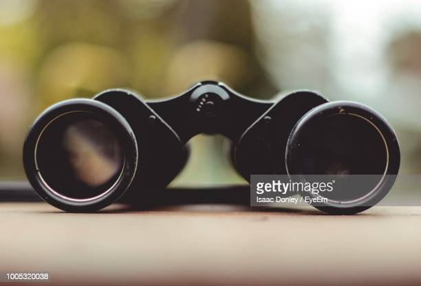 close up of binoculars on table - binoculars stock pictures, royalty-free photos & images