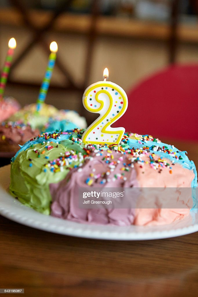 Close Up Of Birthday Cake With Number Two Candle Stock Photo Getty