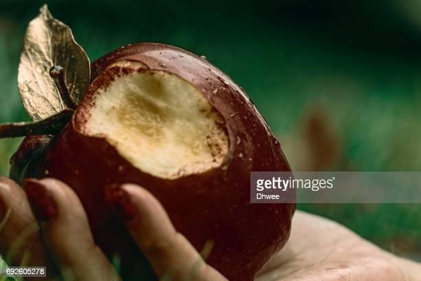close up of bitten apple on hand - snow white imagens e fotografias de stock