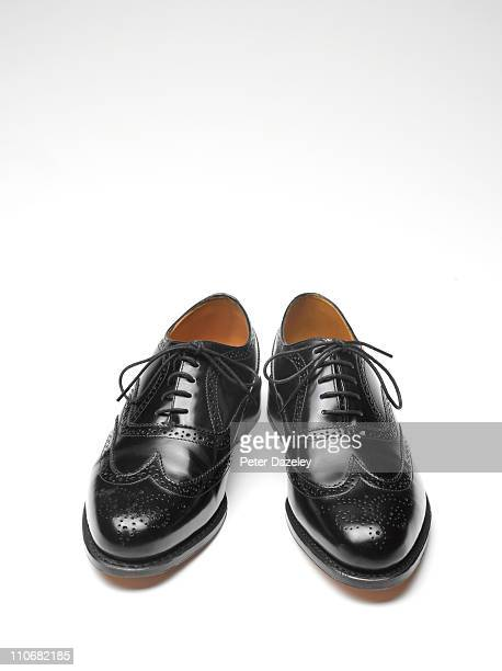 Close up of black brogue shoes with copy space