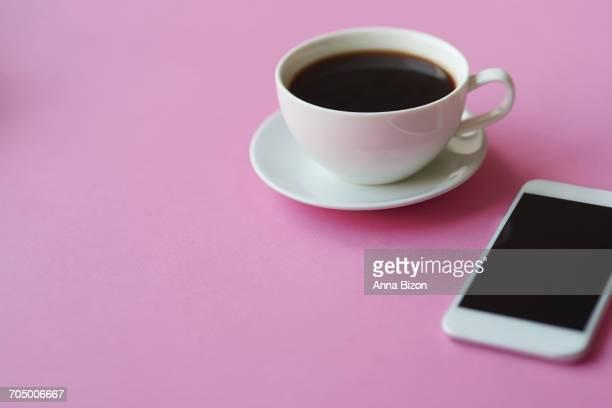 close up of black coffee and smartphone. debica, poland - à côté de photos et images de collection