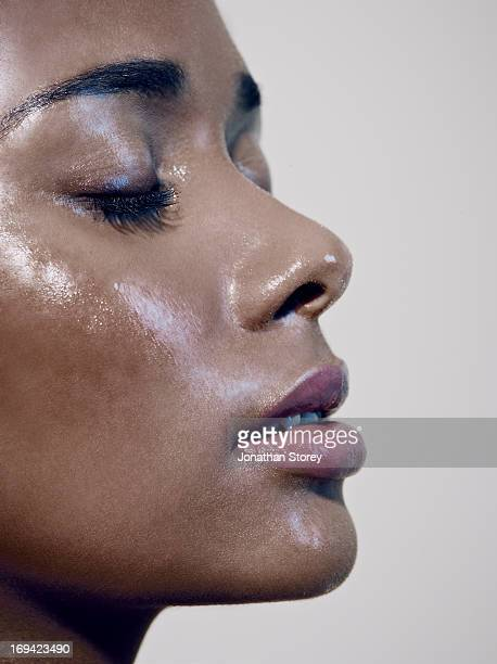Close up of black females face with closed eyes