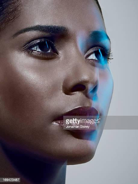 close up of black females face with reflection - editorial stock pictures, royalty-free photos & images