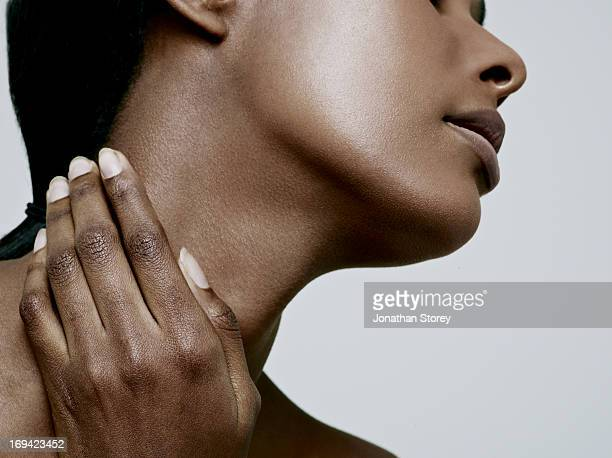 close up of black females neck and chin - touching stock pictures, royalty-free photos & images
