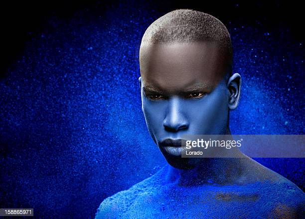 close up of black male model with blue make-up