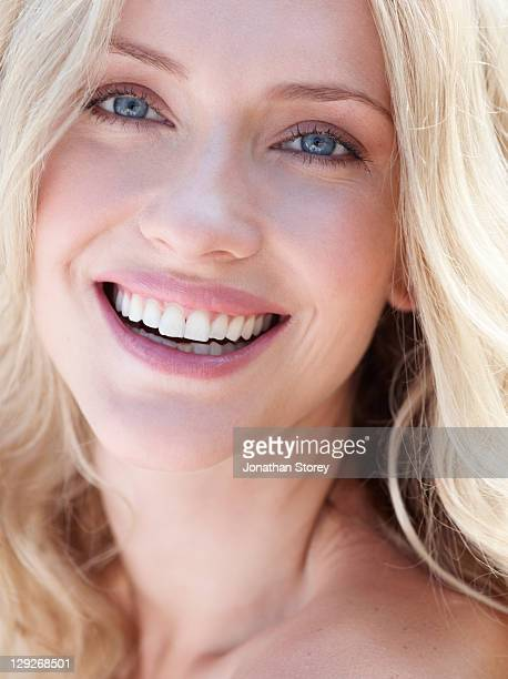 Close up of blond female smiling.