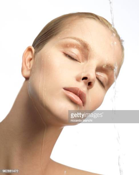 close up of blonde woman with fresh clear healthy skin and water