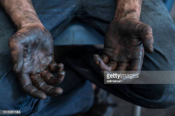 Close Up Of Blue Collar Worker's Hands