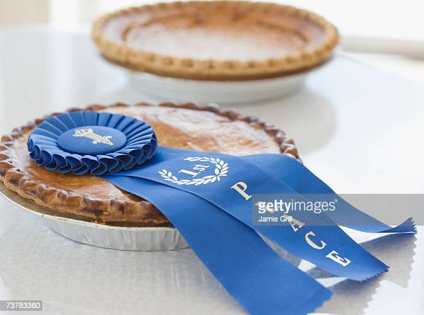 Close up of blue ribbon on pie