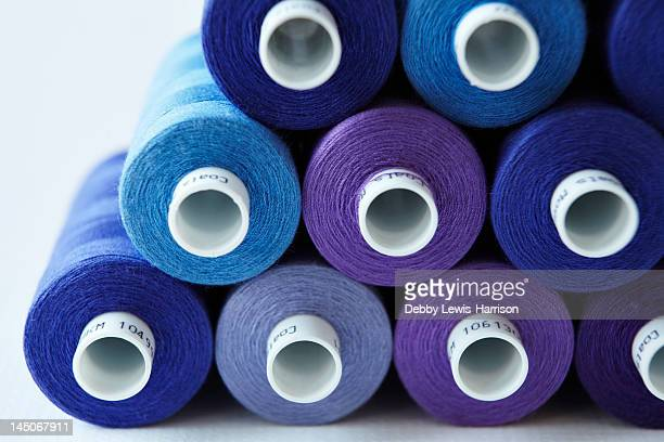 Close up of blue spools of thread