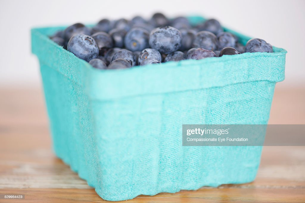 Close up of blueberries in punnet : Stock Photo