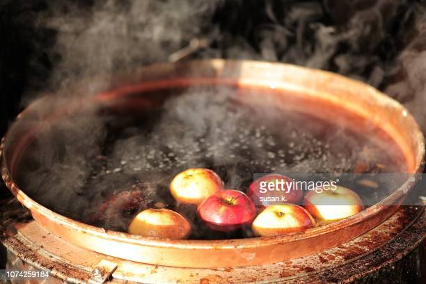 Close up of boiling mulled wine in a cauldron.