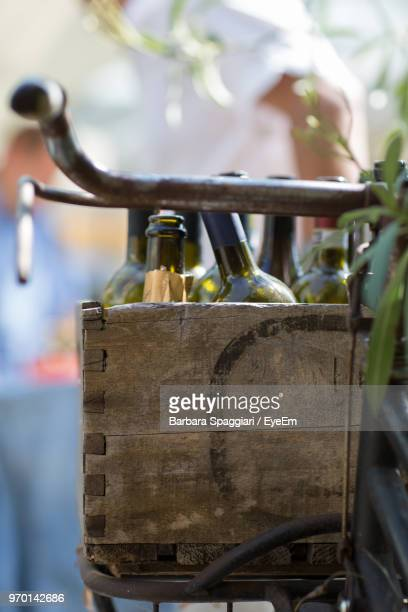 Close Up Of Bottles In Bicycle Basket