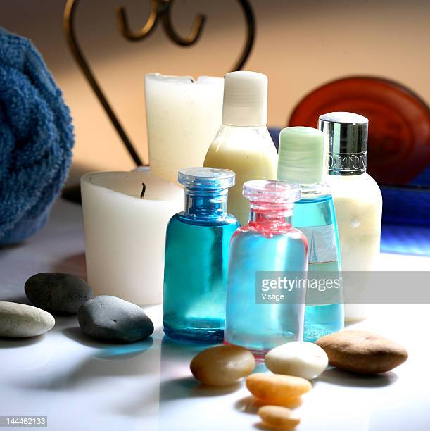 Close up of bottles, pebbles and a candle