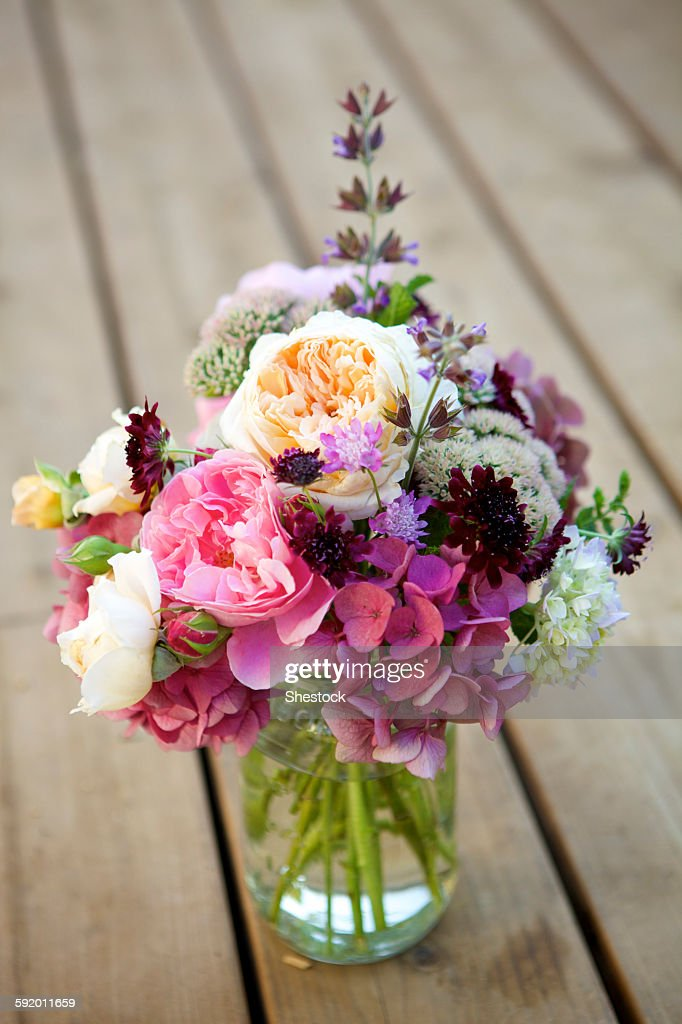 Close up of bouquet of flowers in glass vase : Stock Photo