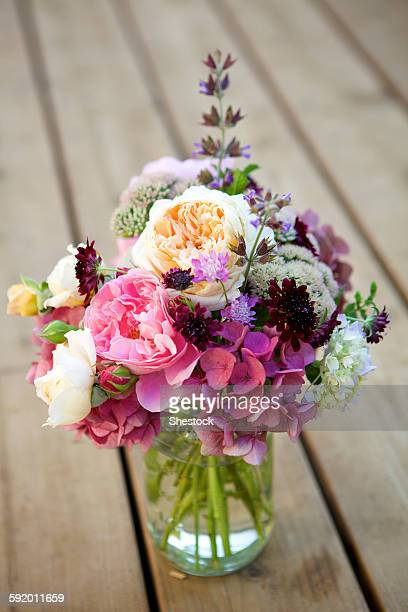 Close up of bouquet of flowers in glass vase