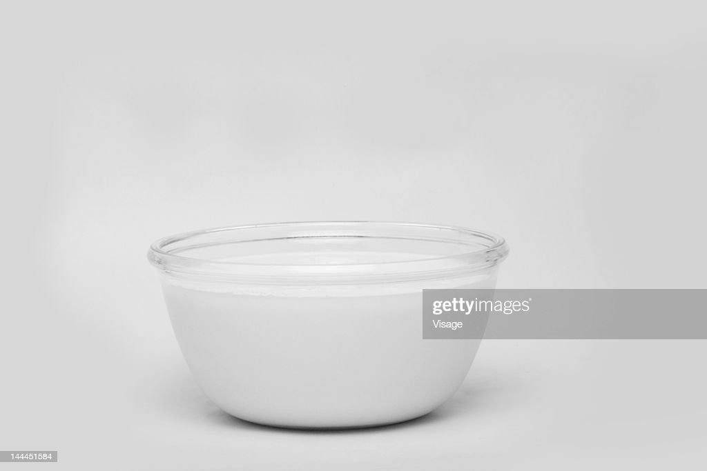 Close up of bowl filled with milk : Stock Photo