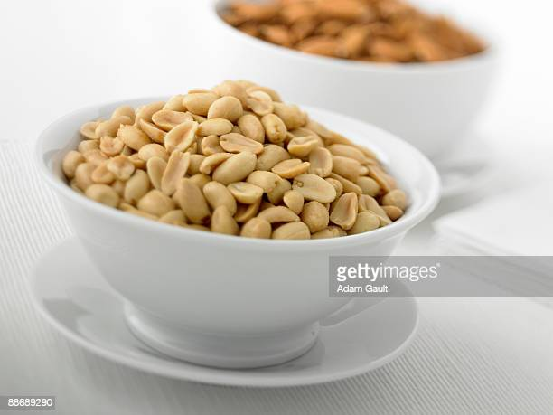 Close up of bowl full of peanuts