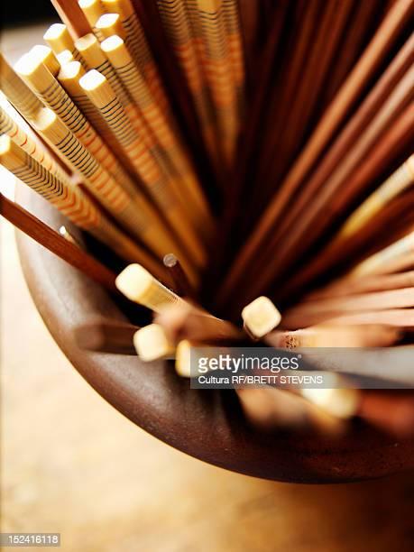 Close up of bowl of chopsticks