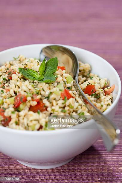 close up of bowl of tabbouleh - tabbouleh stock pictures, royalty-free photos & images
