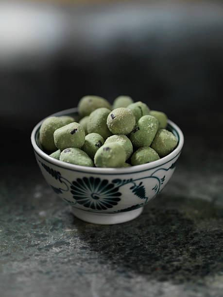Close up of bowl of wasabi peas