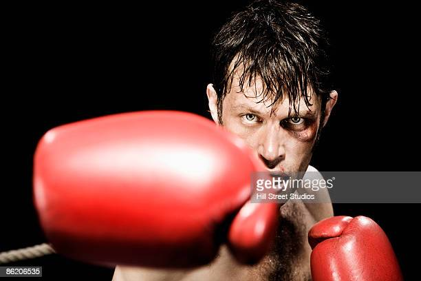 close up of boxer boxing - black eye stock pictures, royalty-free photos & images