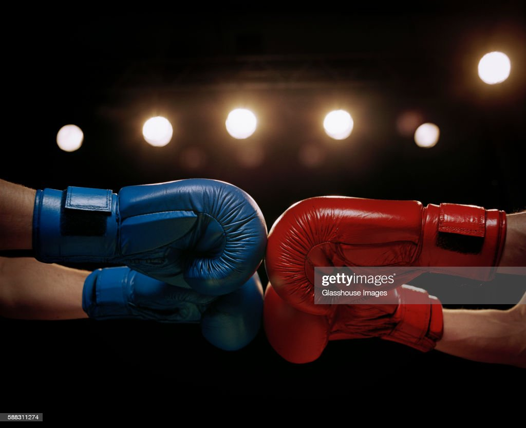 Close Up Of Boxers Touching Boxing Gloves Before Fight ...