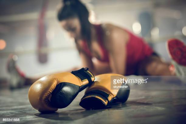 close up of boxing gloves with athlete in the background. - mixed martial arts stock pictures, royalty-free photos & images