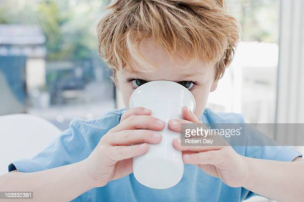 Close up of boy drinking from cup