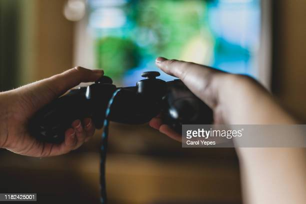 close up of  boy holding game controller - テレビゲーム ストックフォトと画像