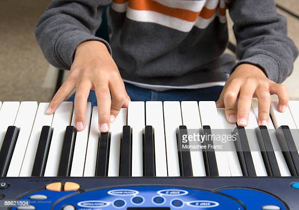 close up of boy playing keyboard - pianist front stock pictures, royalty-free photos & images
