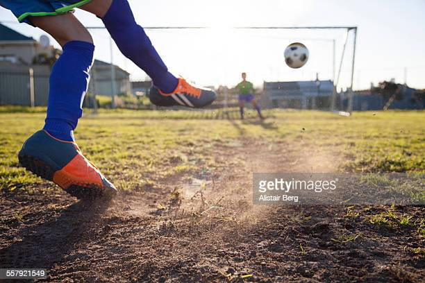 close up of boy taking soccer penalty - tirare in rete foto e immagini stock