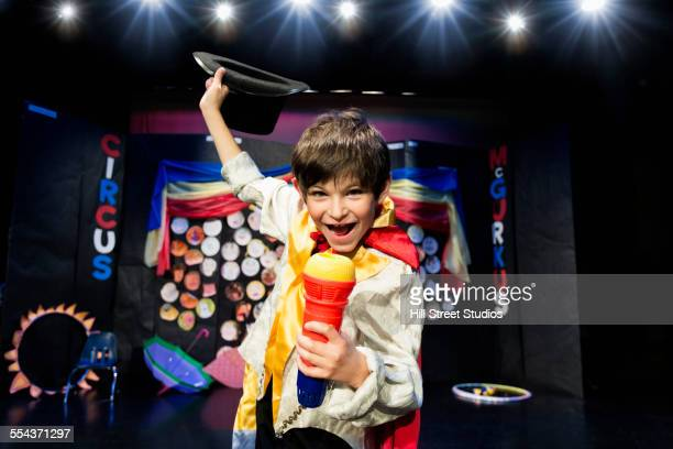 Close up of boy wearing ringmaster costume on stage