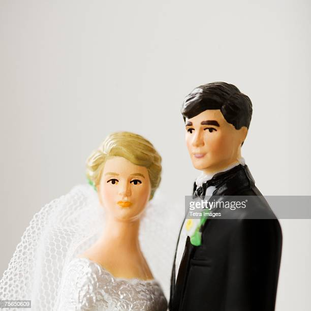 Close up of bride and groom figurines