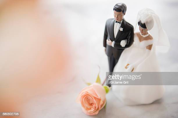 close up of bride and groom wedding cake topper - wedding reception stock pictures, royalty-free photos & images