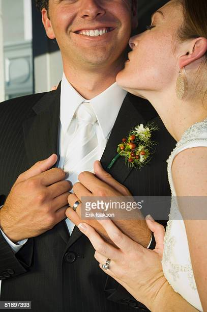 close up of bride kissing groom - admiration stock pictures, royalty-free photos & images