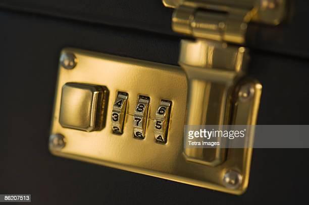 close up of briefcase lock - attaché stockfoto's en -beelden