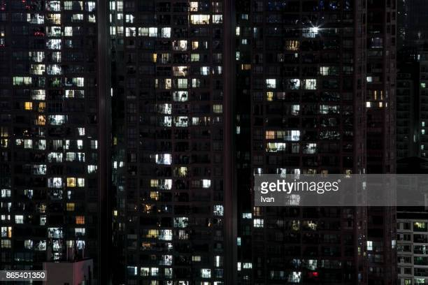 Close up of Bright Windows of High Building Apartment at Night, City Nightview