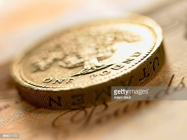 close up of british pound coin and currency - pound symbol stock photos and pictures