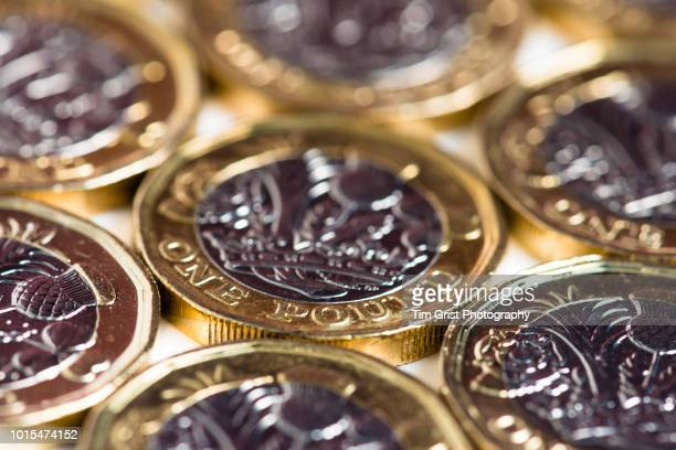 close up of british pound coins - british currency stock pictures, royalty-free photos & images