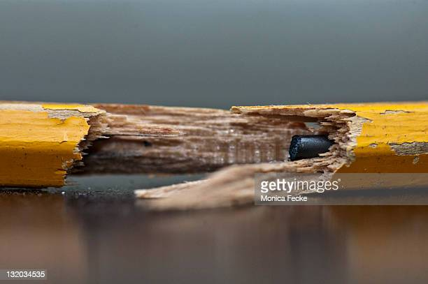 Close up of broken yellow pencil