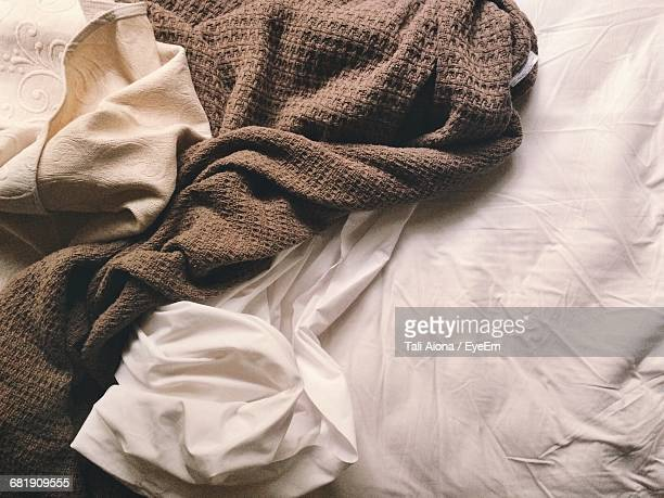 Close Up Of Brown Blanket On Bed