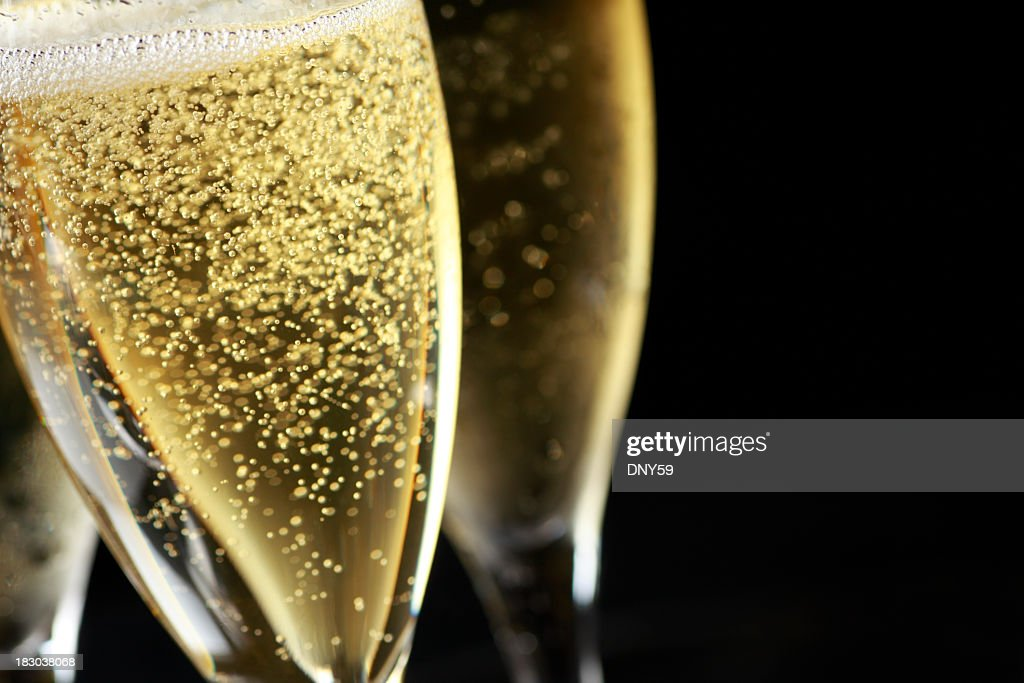 Close up of bubbles in freshly poured Champagne glass : Stock Photo