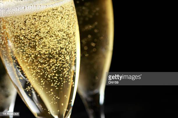 close up of bubbles in freshly poured champagne glass - champagne stock pictures, royalty-free photos & images