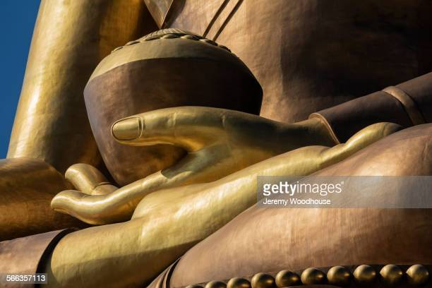 Close up of Buddha statue under blue sky