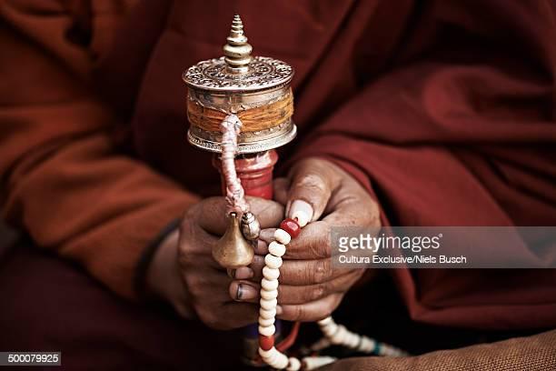 Close up of buddhist monks hands holding prayer beads, Thamel, Kathmandu, Nepal