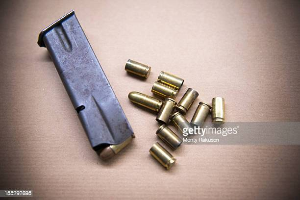 close up of bullet casings - bullet stock photos and pictures