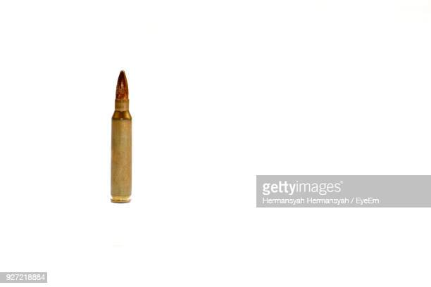 close up of bullet over white background - bullet stock photos and pictures