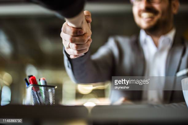 close up of business colleagues came to an agreement in the office. - shaking stock pictures, royalty-free photos & images