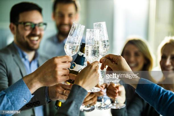 close up of business colleagues toasting with champagne on a party. - honour stock pictures, royalty-free photos & images
